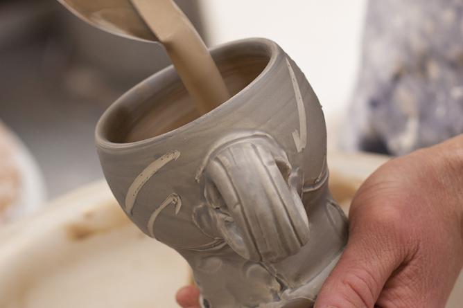Glaze lining ladle pouring into mug