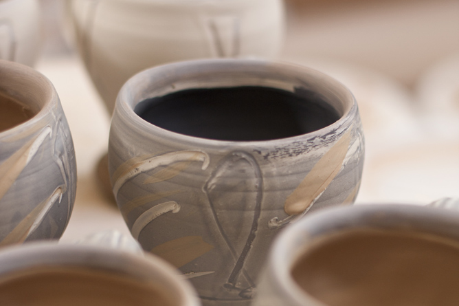 Mug detail slip-decorated awaiting salt-firing