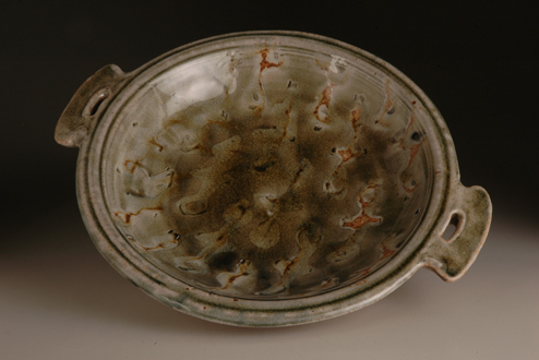 Pasta plate, side-handled, green ash-glaze. Wood-fired salt-glaze