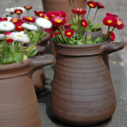 Patia Davis wood-fired terracotta plant pot with flowers