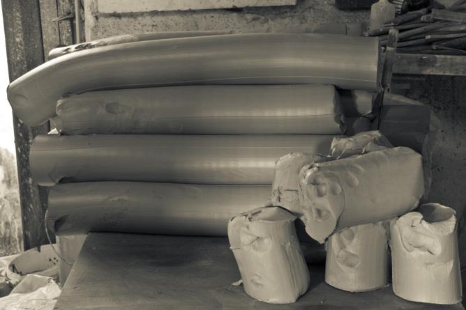 Clay slugs await second pug-milling
