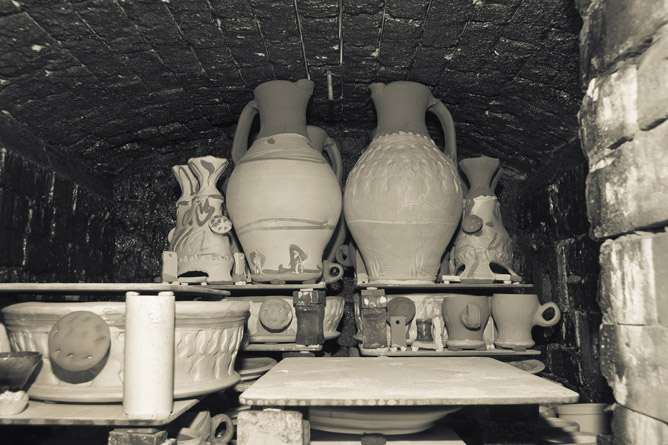 Pots packed tight into chamber of salt-kiln