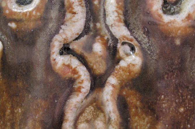 Salt-glaze detail iron scrap motif
