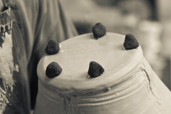 Stoneware jug, wadding up for salt-firing