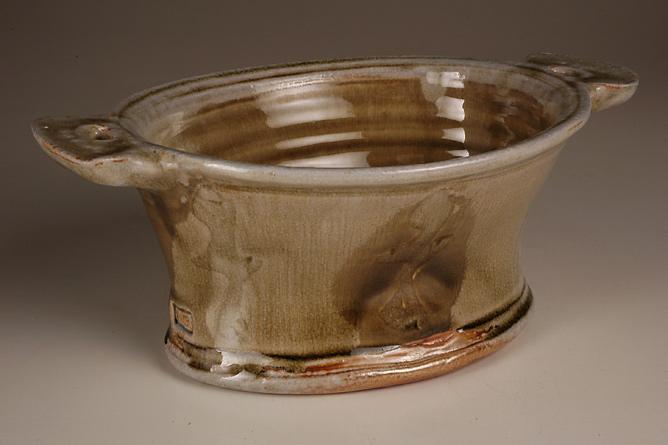 Oval pie dish, side-handled. Wood-fired salt-glaze