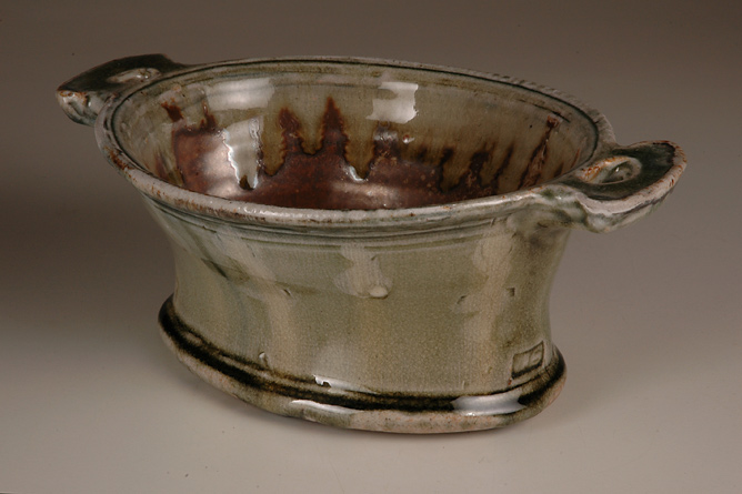 Oval pie dish, side-handled. Ash glaze wood-fired salt-glaze