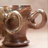 Round mugs, handle detail.