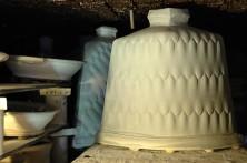 Packing the wood-salt kiln, slabbed bottles