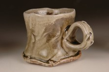 mug rouletted and ash-glazed